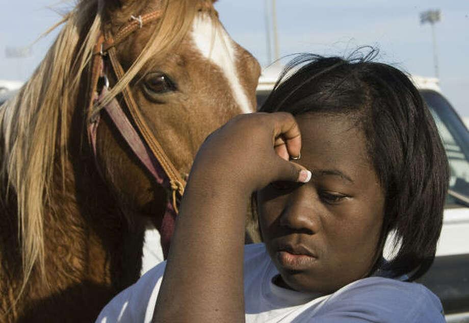 Eboni Price talks about the death of a fellow trail rider, Glenda Pinkney. Photo: Brett Coomer, Chronicle