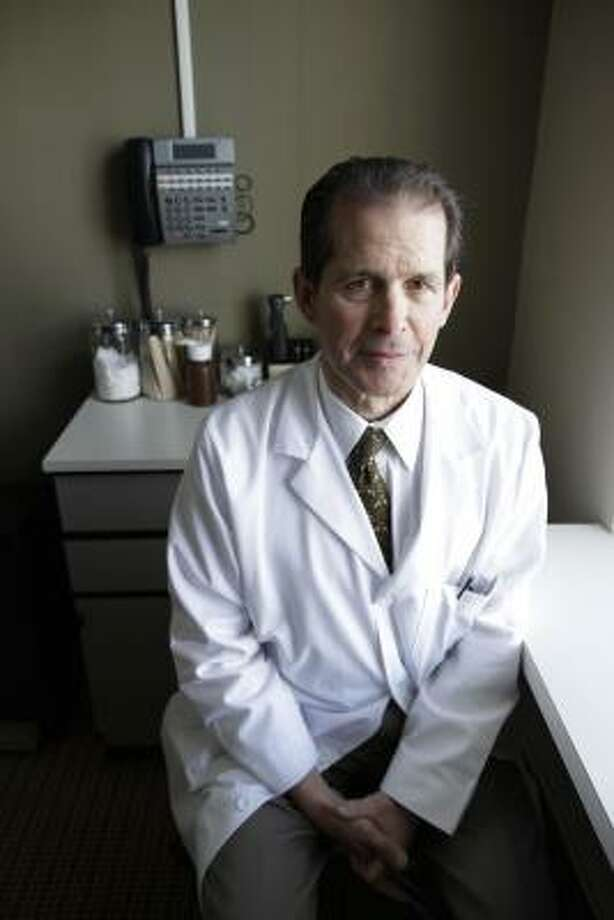 """Dr. Robert Thompson, of Seattle, who voted for Washington's """"Death with Dignity"""" law, says that in his 32 years of practice, he has treated patients who were suffering and would have benefited from the law. Photo: Ted S. Warren, Associated Press"""