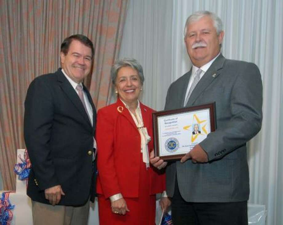 Attending the May 3 Crime Prevention Dinner were, from left: Newell Cheatheam, secretary of the Greater Katy Exchange Club; Harris County District Attorney Pat Lykos, and Fort Bend County Precinct 3 Constable Rob Cook, who was honored as Officer of the Year. Photo: Courtesy, Bob Straus