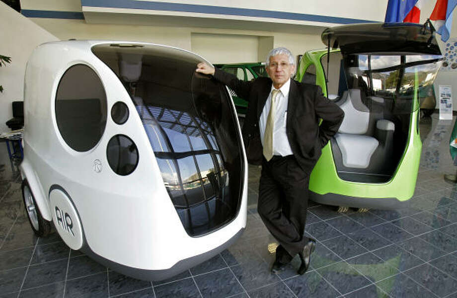 Guy Negre, CEO of Motor Development International, shows the AirPod, a car that runs partly on a compressed air-powered engine, at the MDI head office in Carros, near Nice, France. Photo: LIONEL CIRONNEAU, Associated Press