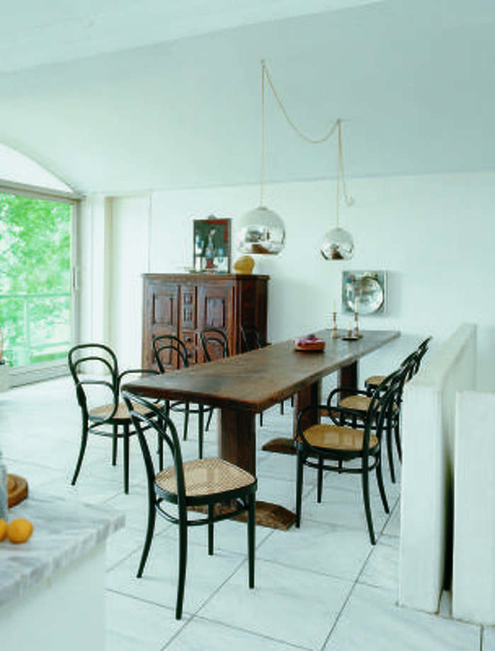 SHIFTING DUTIES: A long, narrow table can pull double duty as a work surface during Monday through Friday and as dining space for entertaining eight visitors for the holiday.
