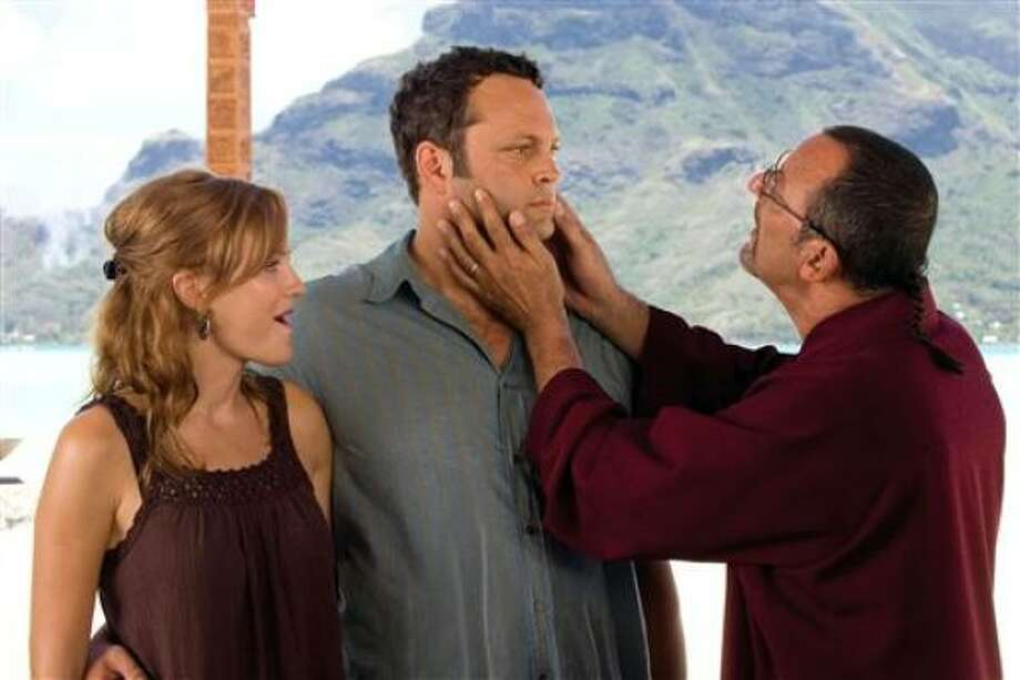 "Malin Akerman, from left, Vince Vaughn and Jean Reno star in ""Couples Retreat."" Photo: John Johnson, ASSOCIATED PRESS 