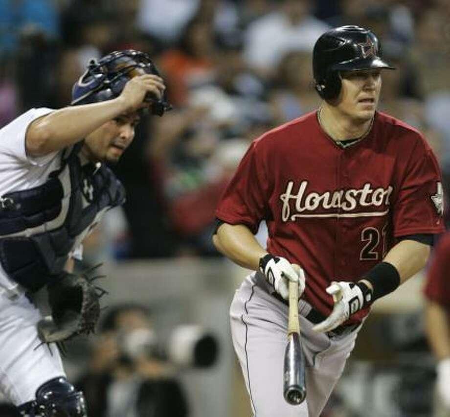 Geoff Blum and Padres catcher Eliezer Alfonzo watch Blum's RBI single in the fourth inning. Photo: Lenny Ignelzi, AP