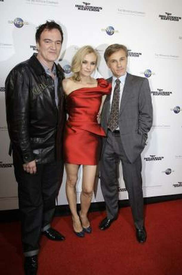 "Quentin Tarantino, left, Diane Kruger and Christoph Waltz, right, arrive for the premier of their movie ""Inglourious Basterd"" at the State Theatre in Sydney, Monday, Aug. 3, 2009. Photo: Rick Rycroft, AP"