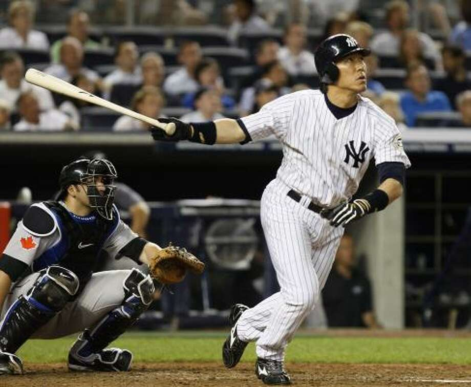 New York Yankees Hideki Matsui watches his eighth inning, game-tying home run in the Yankees 7-5 victory over the Toronto Blue Jays on Tuesday at Yankee Stadium. Photo: Kathy Willens, AP