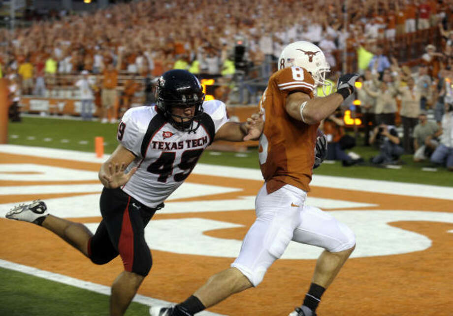 Texas' Jordan Shipley beats Tech punter Donnie Carona to the end zone on a 46-yard return for the Longhorns' first touchdown. Photo: BILLY CALZADA, San Antonio Express-News