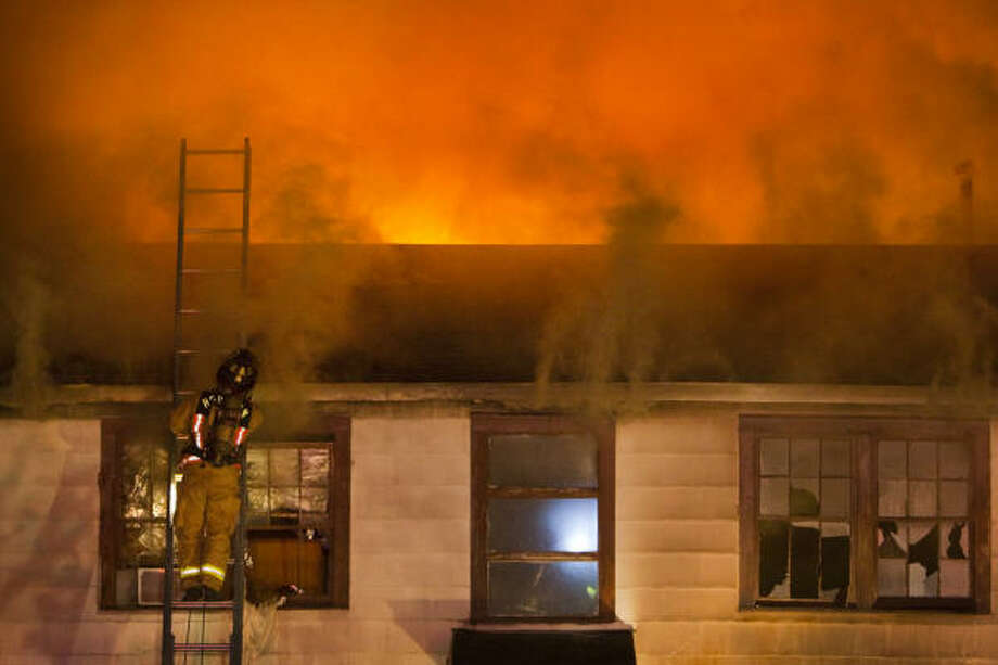 Houston firefighters respond to a fire at 1030 1/2 Ashland in the Heights in the early morning hours today. It's the latest in a string of fires that have hit the Heights, most on the same block of Ashland. Photo: Smiley N. Pool, Chronicle