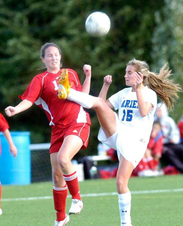 Greenwich's Courtney Callahan collides with Darien's Georgie Highton as Darien hosts Greenwich girls soccer on Wednesday afternoon, Oct. 7, 2009. Greenwich won 4-1. Photo: Keelin Daly / Greenwich Time