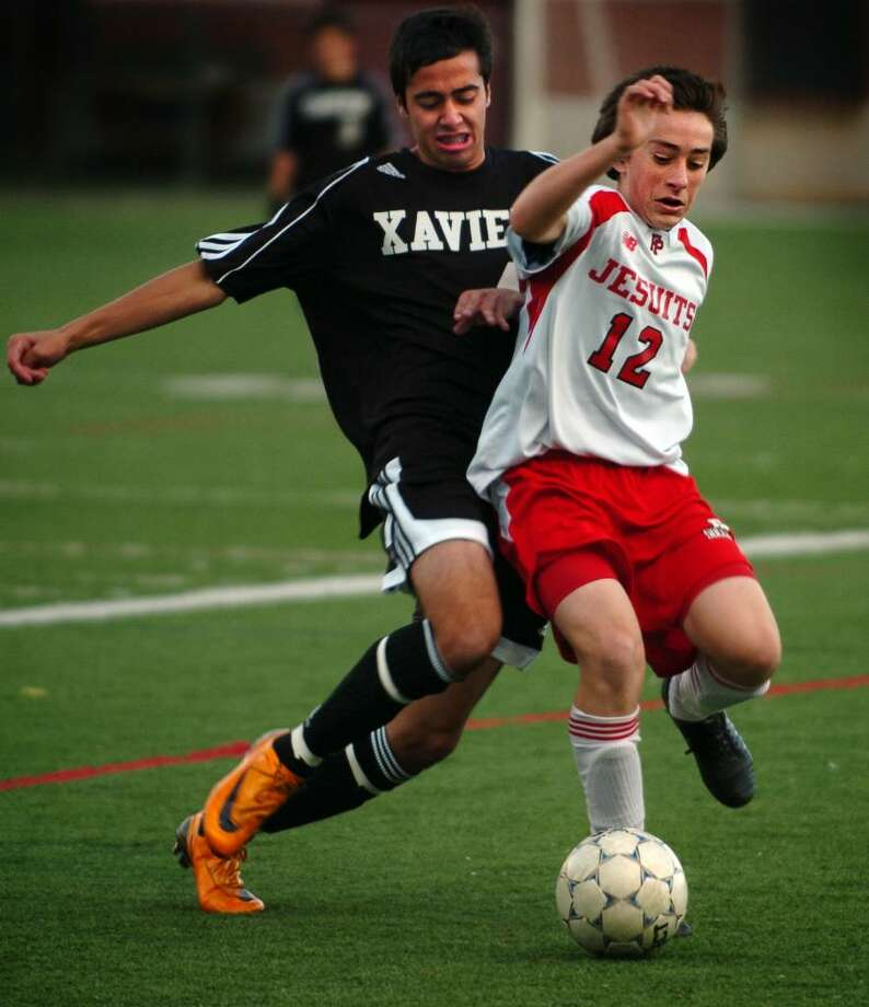 Fairfield Prep's David Bruton and Xavier's Fabricio Liseo chase down the ball during the first half of Wednesday's game at Fairfield University's Alumni Field. Photo: Autumn Driscoll / Connecticut Post