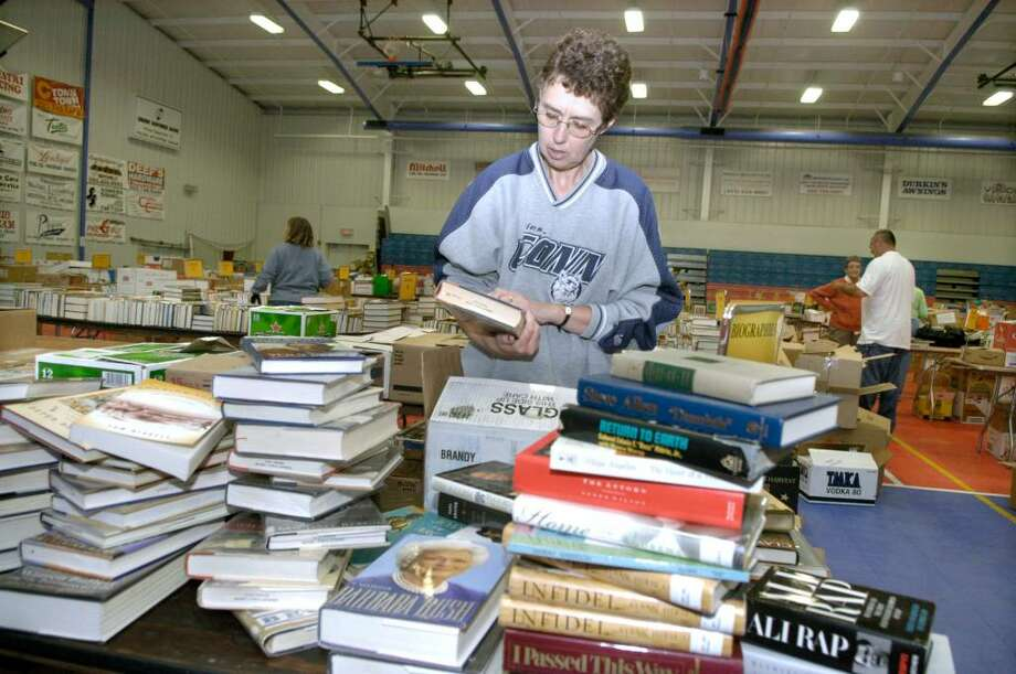 The annual  Friends of the Danbury Library Book Sale will be held Saturday, Volunteers, including Janet Franklin of Danbury, are working hard to prepare for the annual Friends of Danbury Library Book Sale Saturday, Sunday and Monday at the PAL building on Hayestown Rd. in Danbury. There will be over 800,00 items sorted into fifty categories including several rare editions and books of local historical interest. Photo: Carol Kaliff / The News-Times