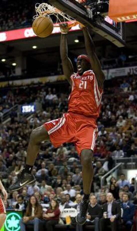 Rockets forward Pops Mensah-Bonsu hangs from the hoop after a dunk. Mensah-Bonsu scored 17 points. Photo: Chris Young, AP