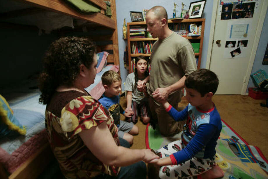 From left, Brandy, James, Megan, Bernie and Michael Hanus gather the night before Bernie departed for training at Camp McGregor in September. Photo: Mayra Beltran, Chronicle