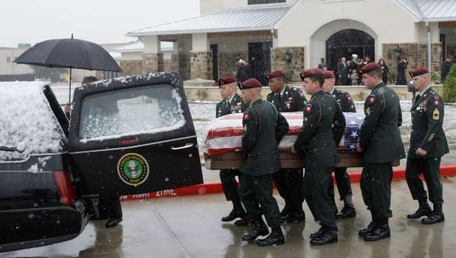 An 82nd Airborne honor guard carries the casket of Sgt. James Michael Nolen after services Friday at Friendswood United Methodist Church.  Photo: Melissa Phillip, Chronicle