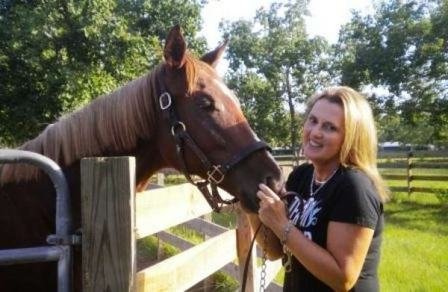 Dana Dean mixes teaching English at Magnolia West High School with owning and training thoroughbreds. Photo: Courtesy Dana Dean