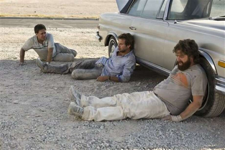 Zach Galifianakis, from left, Bradley Cooper, center, and Ed Helms star in The Hangover. Photo: Warner Bros.