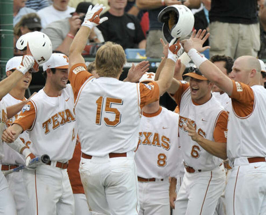 Texas' Russell Moldenhauer (15) celebrates with teammates after hitting a home run against Southern Miss. Photo: Ted Kirk, AP