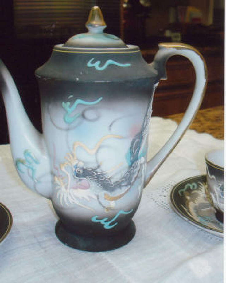 COLLECTIBLE TEAPOT: The collectible Dragonware tea set was made in Japan.