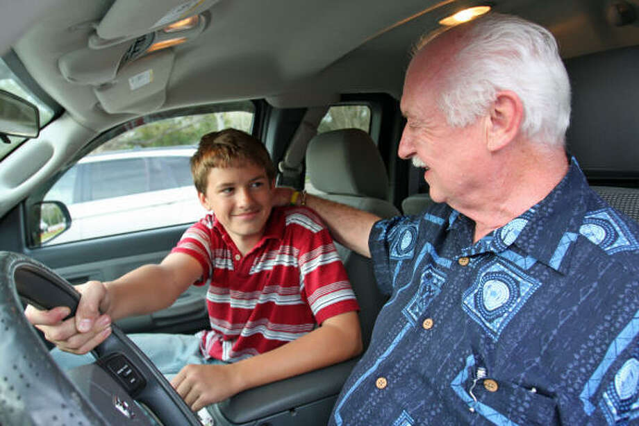 Justin Partain, 15, of Damon, an eighth-grader at Needville Junior High School, took the wheel of the truck his grandfather, Errol Kramer of Missouri City was driving on June 10, and coaxed him safety off the road after Kramer suffered a stroke. Photo: Suzanne Rehak, For The Chronicle