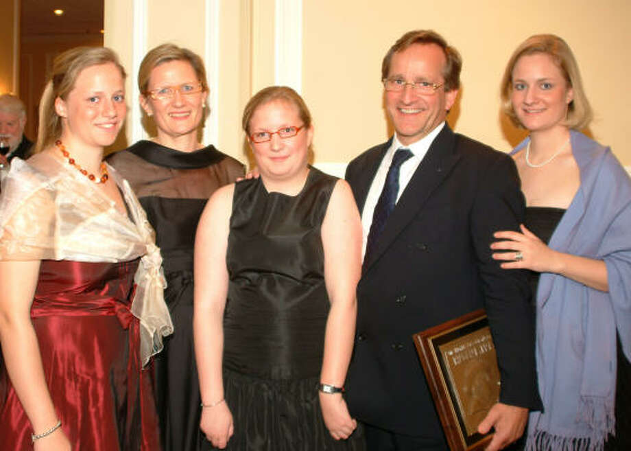 SAY CHEESE: Philippe Cras poses with his family:  daughter Evelyne, 17, left, wife Mieke,  and daughters Pauline, 15, and Nathalie, 19. The Belgium native was named the Humble Chamber's Citizen of the year at an awards ceremony Feb. 27. Photo: Carolyn Prescott, For The Chronicle