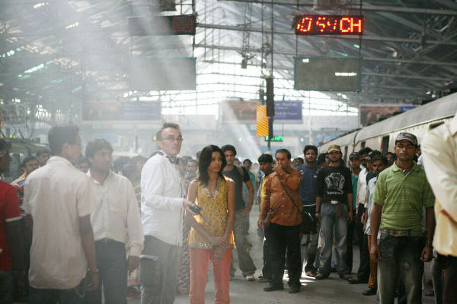 Danny Boyle, third from left, directs a scene from Slumdog Millionaire. Photo: ISHIKA MOHAN, FOX SEARCHLIGHT | ASSOCIATED PRESS