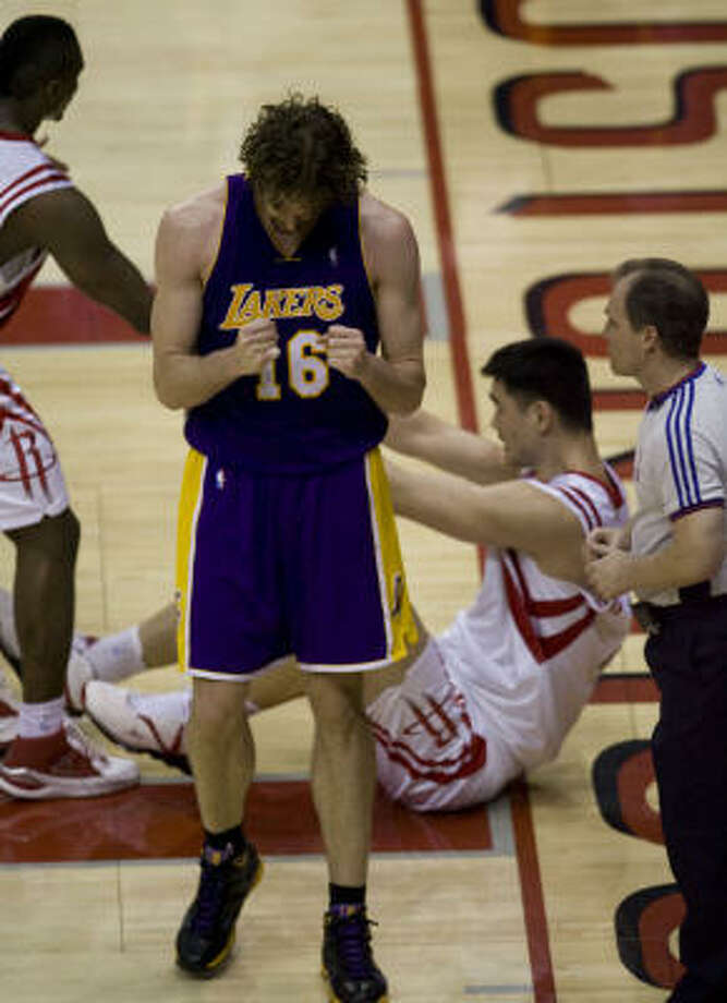 Lakers center Pau Gasol (16) was pumped up about getting the better of Yao Ming after a fourth-quarter collision during the Lakers' win Friday night in Game 3 at Toyota Center. Photo: Brett Coomer, Chronicle