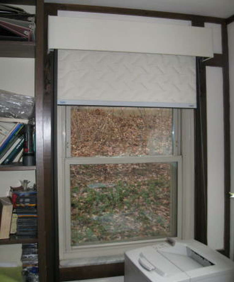 An insulating window shade with sealed sides blocks all three modes of heat loss and improves comfort when sitting near a window.