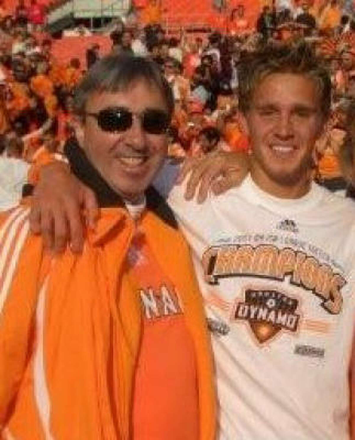 Dynamo midfielder Stuart Holden, right, shares a moment with his father, Brian, who died earlier this year from cancer.
