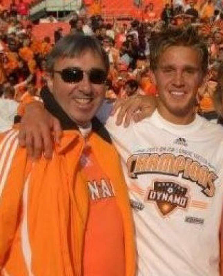 Dynamo midfielder Stuart Holden, right, shares a moment with his father, Brian, who died earlier this year from cancer. Photo: Chronicle File
