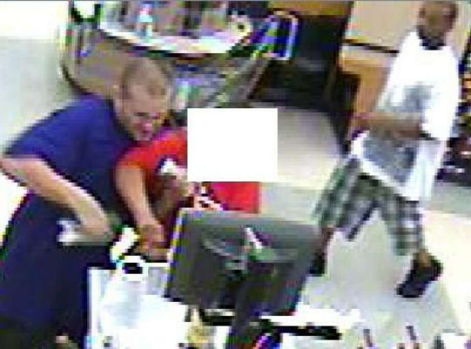 Sheriff's investigators said two men robbed a Kroger in the 19300 block of West Lake Houston Parkway about 1:20 a.m. on Monday. Photo: Harris County Sheriff's Office