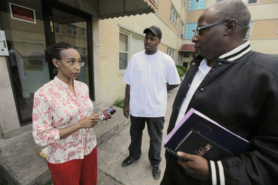 Tifanni Sterdivant of Corner Office Management instructs George Outland, right, and Ralph Turner at an apartment complex in Chicago. Outland is paid $8 an hour to answer phones, enter data and learn to manage accounts. Photo: M. Spencer Green, ASSOCIATED PRESS