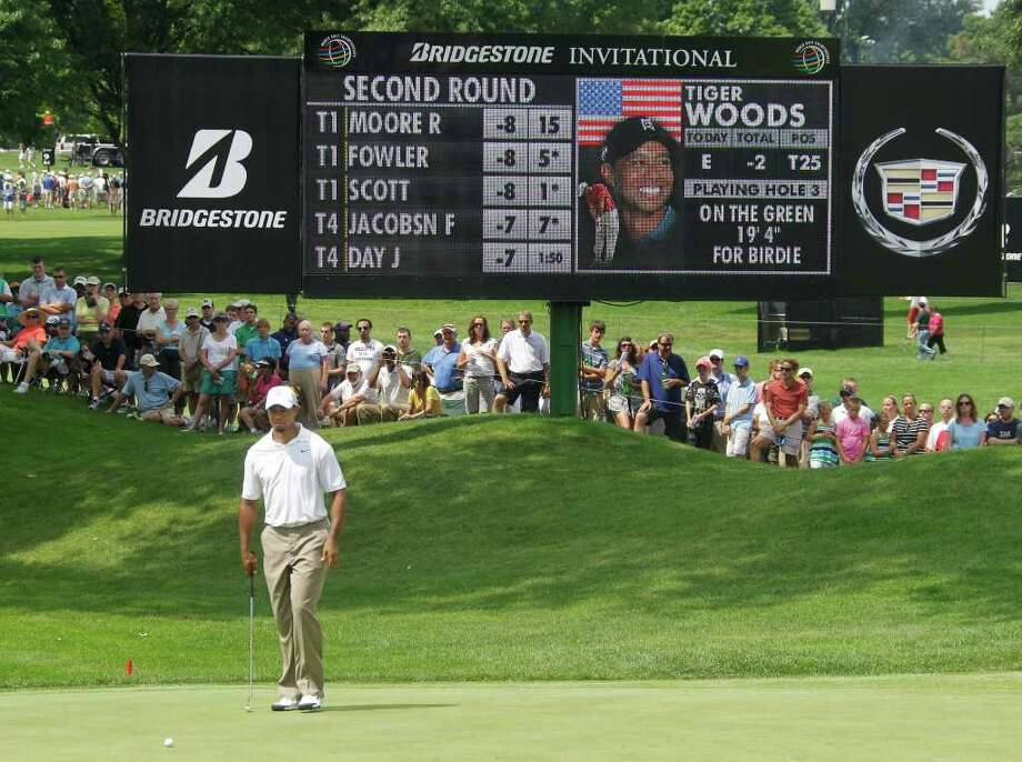 Tiger Woods looks over his putt on the third hole during the second round of the Bridgestone Invitational golf tournament at Firestone Country Club in Akron, Ohio Friday, Aug. 5, 2011. (AP Photo/Mark Duncan) Photo: Mark Duncan, STF / AP