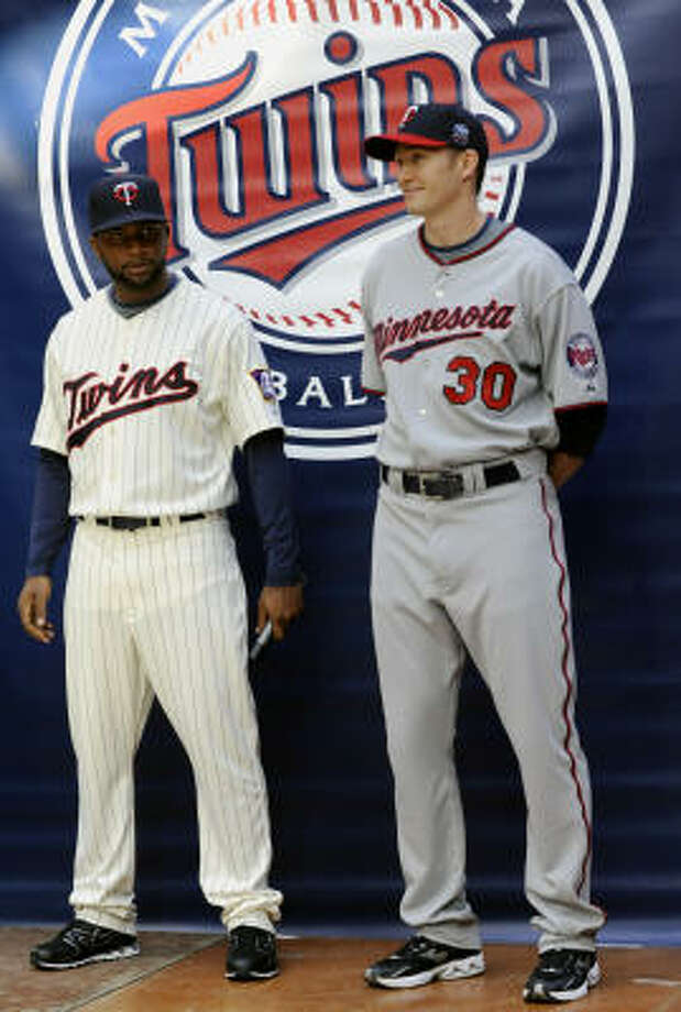 Twins outfielder Denard Span, left, and pitcher Scott Baker model the team's new uniforms for the 2010 season. Photo: Jim Mone, AP
