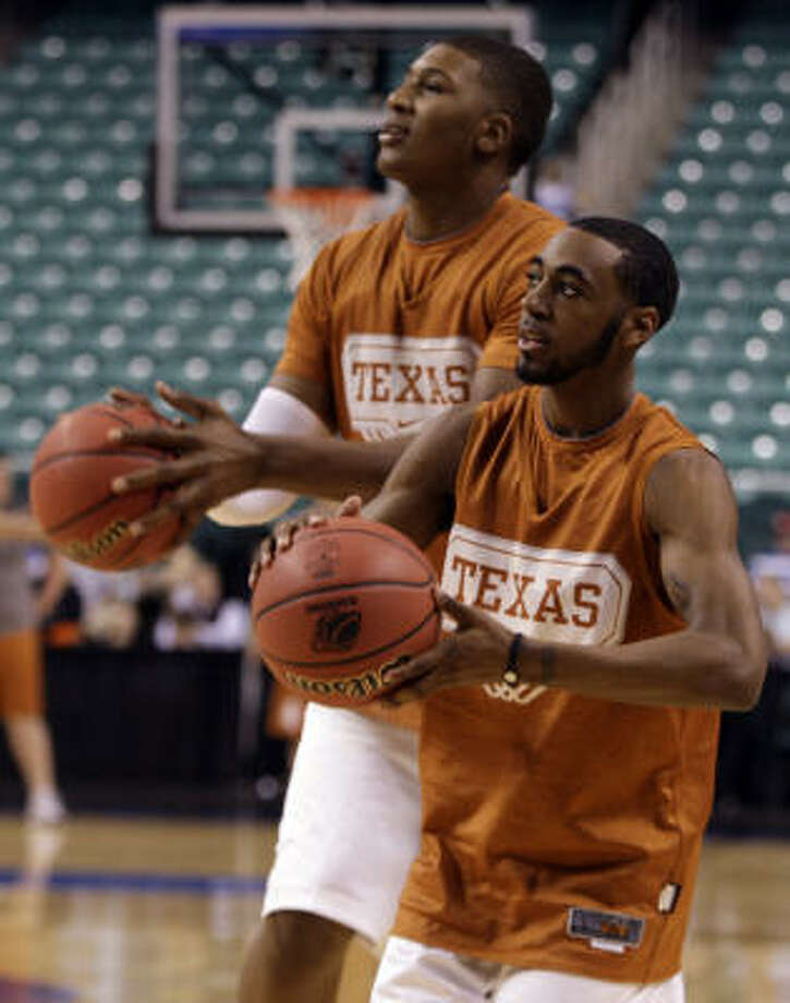 Texas' inside-outside combination of Dexter PIttman, left, and A.J. Abrams warm up Wednesday. Photo: Steve Helber, AP