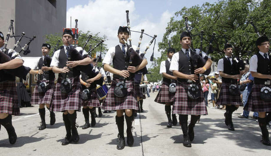 In appropriate entertainment for a year when iFest focuses on Ireland, members of St. Thomas' Episcopal School Pipe Band march to the stage Saturday for their performance at the Houston International Festival held downtown. Photo: Melissa Phillip, Chronicle