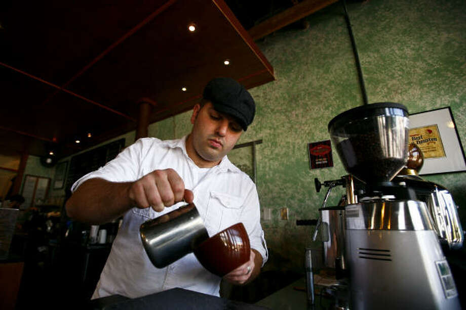 Sean Marshall, left, a barista at Catalina Coffee and owner of Fusion Beans, works with his boss and owner of Catalina Coffee, Max Gonzalez. Marshall recently won a competition in Orlando, Fla., and will compete next year in a barista competition in China.  Photo: Michael Paulsen, Chronicle