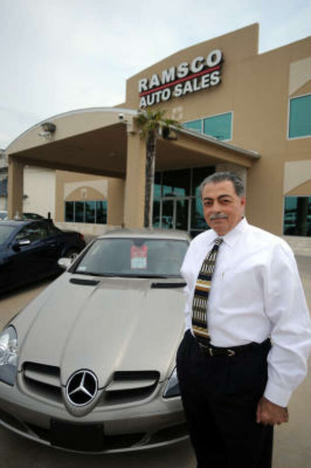 Ramsey Albaba is the owner of Ramsco Auto Sales at 9545 W. Little York. Photo: Thomas Nguyen, For The Chronicle