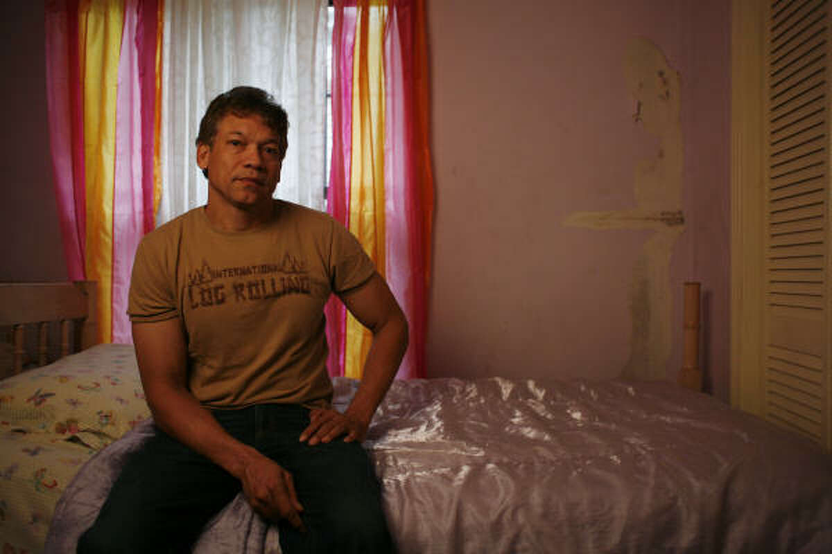 Manuel Quezada, lead plaintiff in a lawsuit against Farmers, shows some of the damage Hurricane Ike caused in a bedroom of his Sharpstown home.