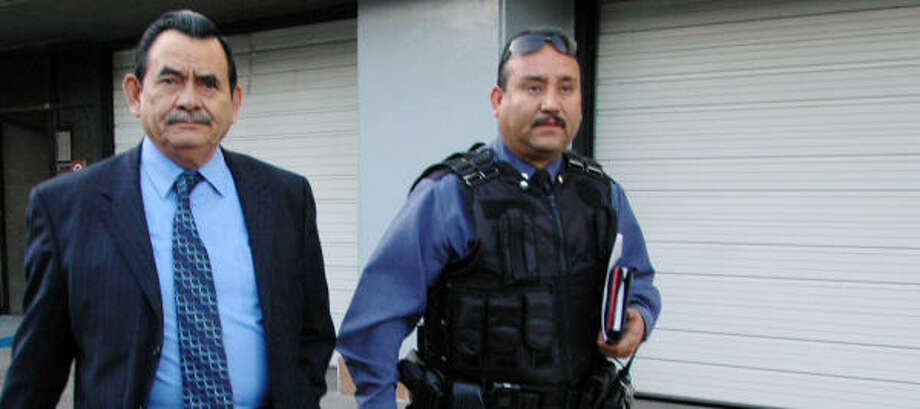 Public Safety Secretary Roberto Orduna (left), a retired Army officer, had been on the job for less than a year. Photo: AP