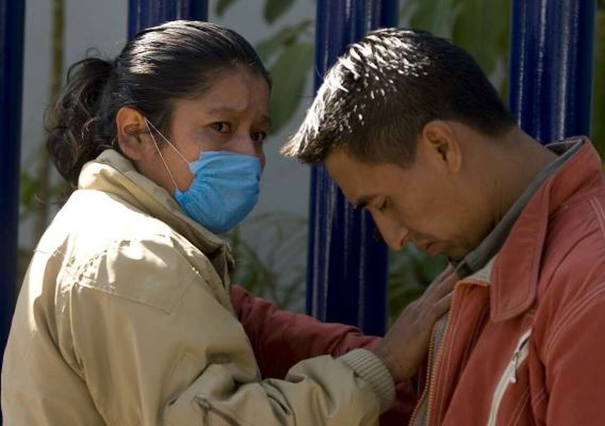 Relatives of Juana Garcia react to her death this week outside the National Institute of Respiratory Illnesses in Mexico City. According to relatives, Garcia had symptoms of the swine flu, although hospital authorities did not officially diagnose her with the disease.