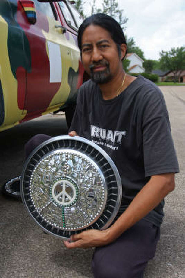 Don Seributra of Missouri City has his Art Car almost ready for the Saturday Art Car Parade. Photo: Suzanne Rehak, For The Chronicle