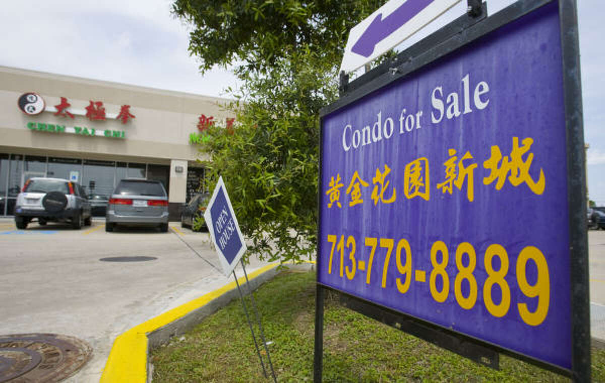 """A """"Condo for Sale"""" sign stands outside Sterling Plaza at 9888 Bellaire in southwest Houston's Chinatown. Several shopping centers in Chinatown offer businesses the opportunity to own their retail spaces."""