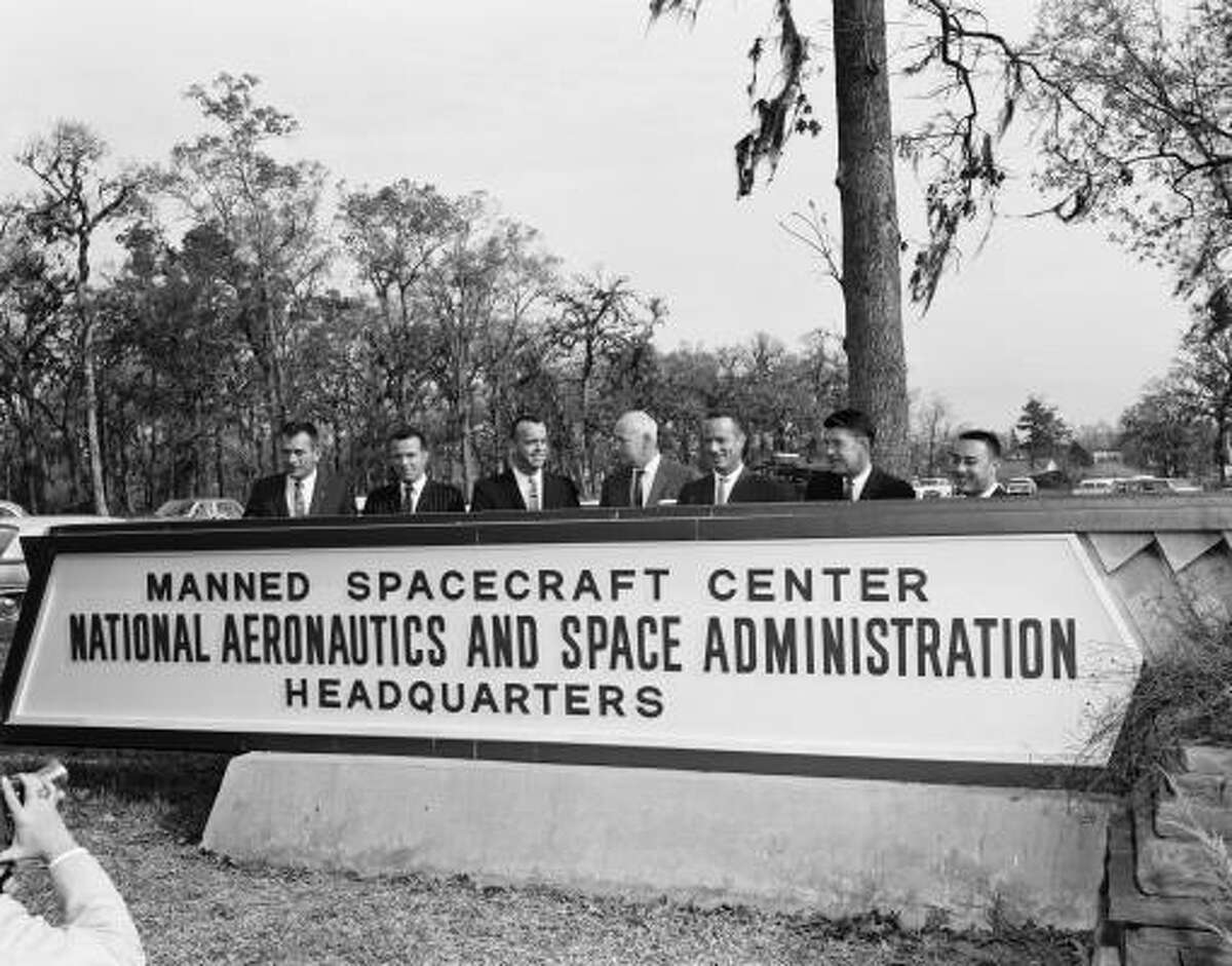 """Dr. Robert Gilruth, the Manned Spacecraft Center's first director, is flanked in the early 1960s by six of the Mercury 7 — from left, """"Deke"""" Slayton, Gordon Cooper, Alan Shepard, Gilruth, Scott Carpenter, """"Wally"""" Schirra and """"Gus"""" Grissom."""