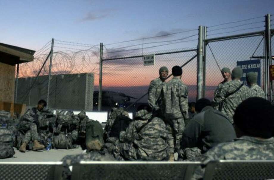 U.S. soldiers wait for flight at the airfield in Kandahar province south of Kabul, Afghanistan. Another 20,000 troops are expected to join the soldiers in the southern region. Photo: RAHMAT GUL, ASSOCIATED PRESS