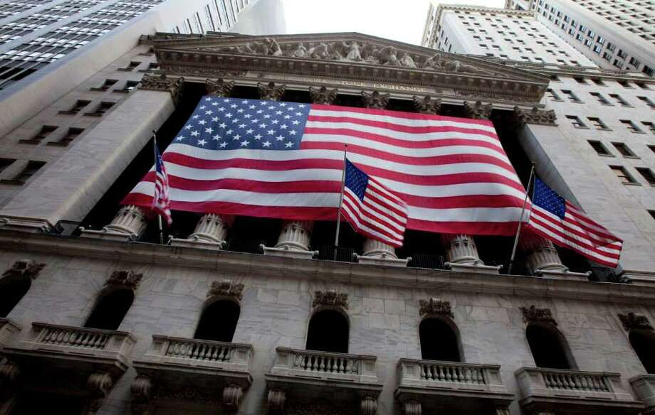 U.S. flag flies from the New York Stock Exchange on Friday, Aug. 5, 2011 in New York.  Fears that the economy might dip back into recession helped send the Dow Jones industrial average down 513 points on Thursday. European leaders are struggling to contain that region's debt problems, prompting comparisons to the 2008 financial crisis. Markets tumbled from Tokyo to London Friday as overseas traders reacted to the selloff. (AP Photo/Jin Lee) Photo: Jin Lee, FRE / FR159730 AP