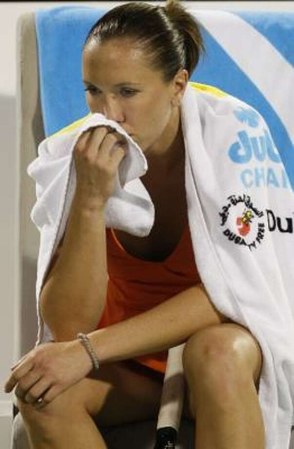 Jelena Jankovic ponders her loss to Kaia Kanepi. Photo: Kamran Jebreili, AP