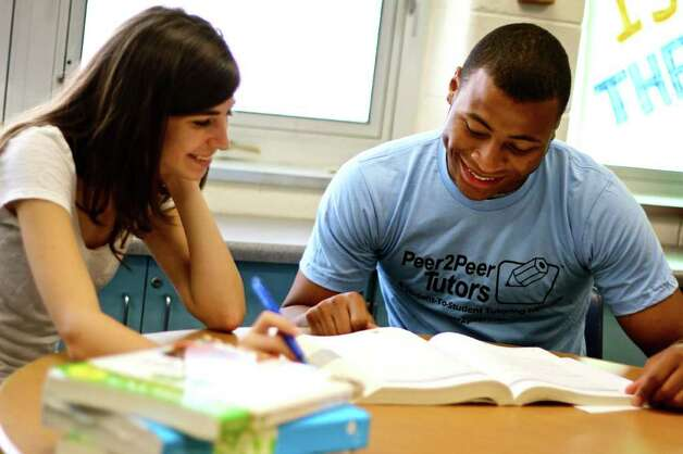 A Peer2Peer tutor aissists a student. Photo: Contributed Photo