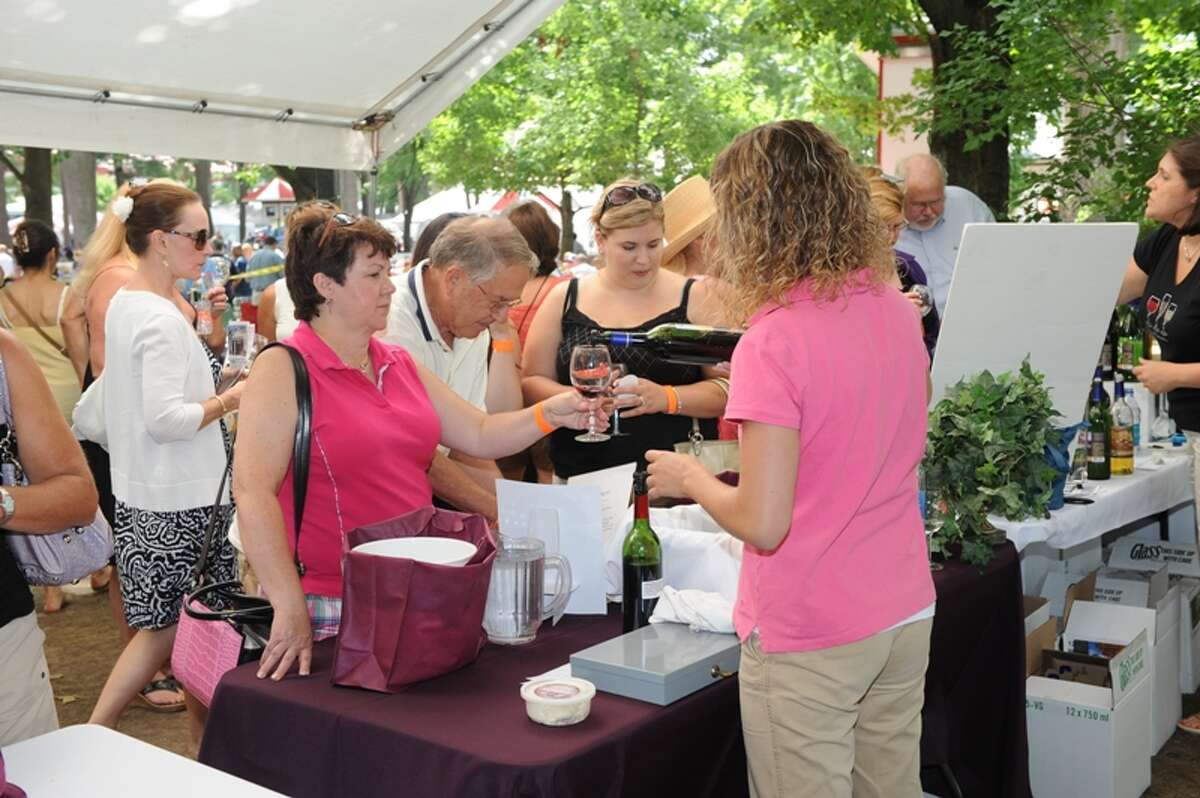 Wine aficionados peruse the offerings at last year's ?Galloping Grapes: A New York Wine Event? at Saratoga Race Course. (Ed Lewi Associates)