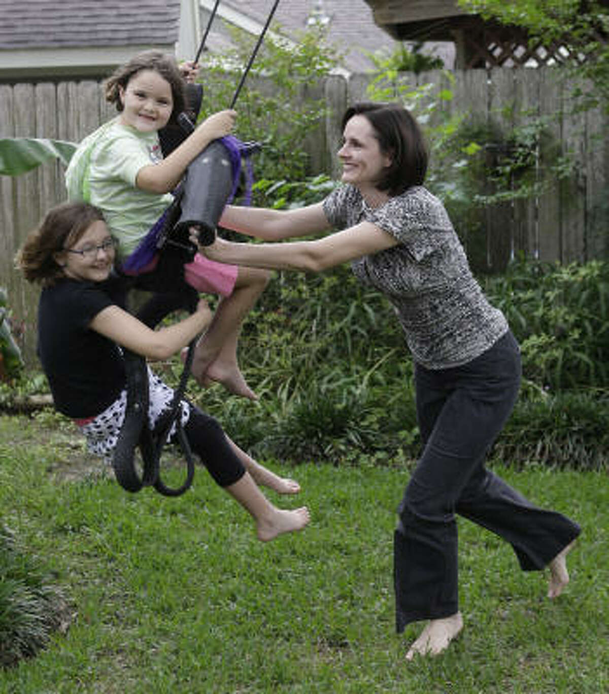 Olivia Ober says finances are part of the reason she plans to take daughters Elizabeth, 7, and Rebekah, 6, out of private school for a hybrid home-schooling program based out of a church.