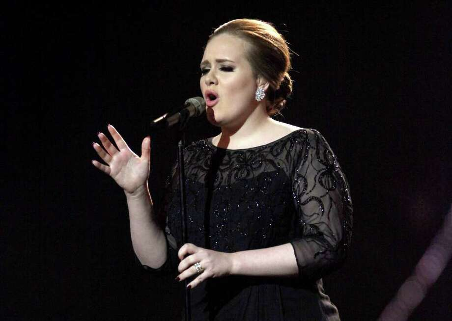 FILE - In this Feb. 15, 2011 file photo, Adele performs on stage during the Brit Awards 2011 at The O2 Arena in London. Adele will make her first appearance performing at MTV Video Music Awards, airing Aug. 28, in Los Angeles.  (AP Photo/Joel Ryan, file) Photo: Joel Ryan / AP2011