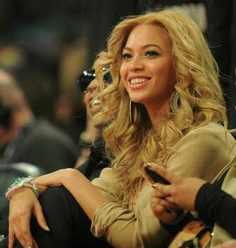 Beyonce attends the NBA All-Star Game February 20, 2011, part of NBA All-Star Weekend at Staples Center in Los Angeles, California. AFP PHOTO / Robyn Beck (Photo credit should read ROBYN BECK/AFP/Getty Images) Photo: ROBYN BECK / AFP